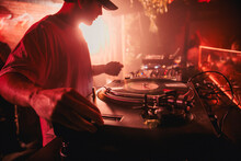 DJ Mixing Music During Party In Club