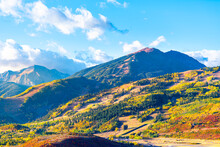 View Of Aspen City, Colorado USA And Buttermilk Ski Slope Hill In Rocky Mountains Peak With Colorful Autumn Foliage Aspen Trees In Roaring Fork Valley