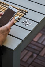 Crop Man Scanning QR Code Of Restaurant Menu