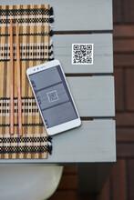 Smartphone And QR Code Of Menu In Restaurant