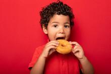 Cute Boy Eating Donut In Studio