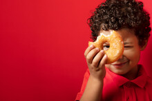 Funny Child With Donut In Studio