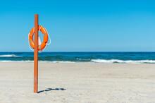 Life Buoy Preserver On Sandy Beach Somewhere