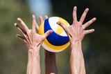 Volleyball game. Beach volleyball block.