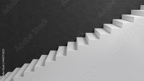 Fotografia Ascending white stairs on black wall background
