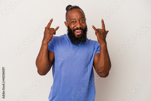 Fotografering African american man with beard isolated on pink background showing a horns gesture as a revolution concept