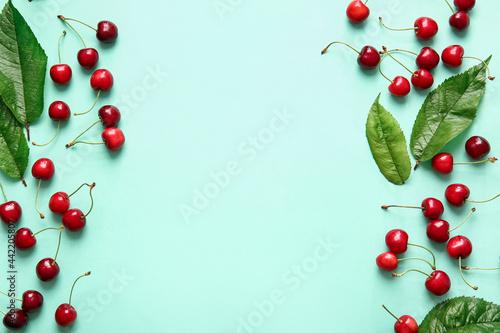 Obraz na plátně Tasty ripe cherry on color background