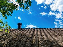 Slate Roof Of The House With A Chimney.
