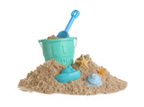 Fototapeta Kawa jest smaczna - Plastic beach toys on pile of sand against white background. Outdoor play