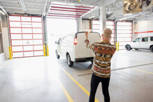 Young Man Guiding Moving Van Backing Into Loading Dock