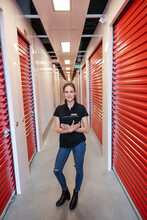 Portrait Confident Female Storage Facility Worker In Corridor