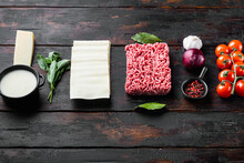 Different Ingredients For Lasagna, On Old Dark  Wooden Table Background, With Copy Space For Text