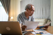 Depressed Asian Senior Elderly male feel worry about financial problem