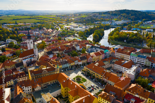 Obraz na plátne Aerial view of Old Town of Czech city of Pisek on Otava river overlooking white