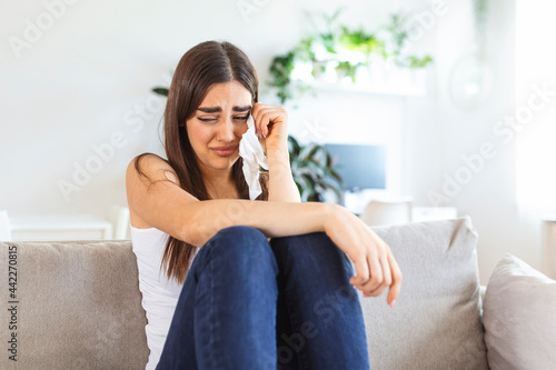 Tablou Canvas Unhappy young woman covering face with hands, crying alone close up, depressed g