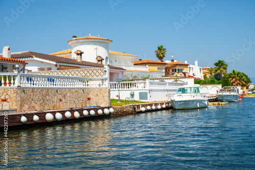 Beautiful and cozy resort town, Empuriabrava town in summer atmosphere, canal wi Fototapet
