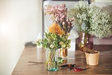 Beautiful Fresh-cut Green Hellebores And Orange Pincushion Protea Blooms
