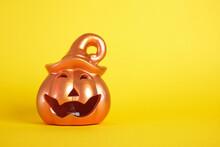 A Ceramic Halloween Jack O Lantern Pumpkin On Yellow Background