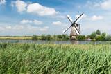 Fototapeta Paryż - View of a windmill at Kinderdijk, Alblasserwaard, Netherlands