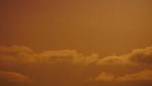 Orange Sunrise Sky With Clouds