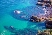 Crystal Clear Ocean Water With Rocks Protruding From The Water At The Knysna Lagoon, South Africa