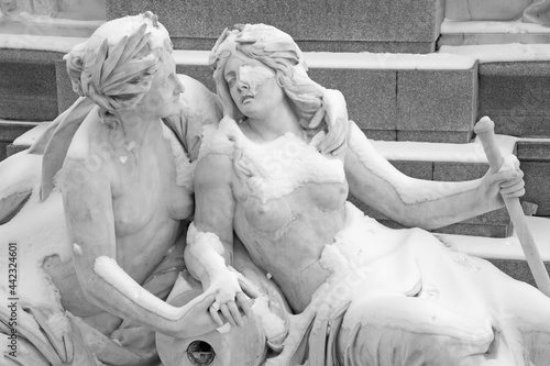 Fotografia, Obraz Vienna - Detail of Allegorical statues of rivers Elbe and Moldau in the front of the Parliament in Vienna as the part of Pallas Athena fountain