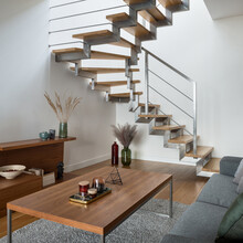 Modern Stairs With Silver Elements In Living Room With Wooden Decor
