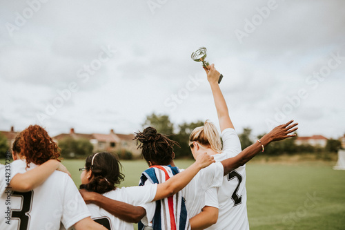 Fotografie, Obraz Female football players taking a winning cup back home