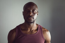 Portrait Of Fit African American Man Exercising At Gym, Looking Straight To Camera