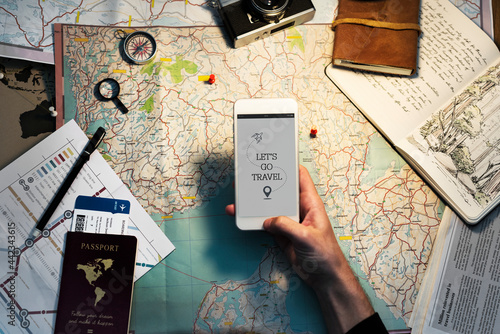 Canvas Print Closeup of hand with mobile phone over map background