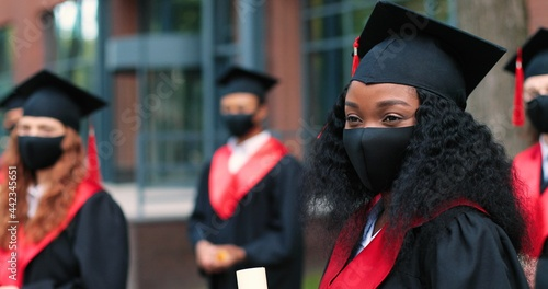 Portrait view of the cute multiracial student woman wearing protective mask stan Fotobehang
