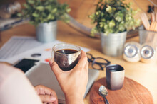 Close Up Hands Of Woman Sitting Office Desk Holding Sweet Coffee Cup Relax And Enjoy With Happy Time. Hot Coffee Mug In Hand. Woman Holding Coffee Cup Relaxing After Work At Office Warm Taste In Cafe