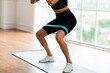 Closeup Of Woman In Black Sportswear Exercising With Elastic Band