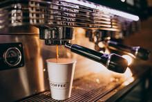 Barista Making Coffee In A Coffee Machine In A Cardboard