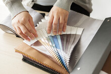 Female Designer With Fabric Color Samples Choosing Textile For Curtains