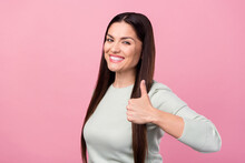 Photo Of Attractive Lovely Young Woman Show Hand Thumb-up Recommend Smile Isolated On Pink Color Background