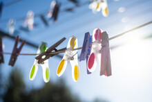 Clothesline Pegs Hanging On A Sunny Morning