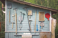 A Board With Tools On The Wall Of The Shed