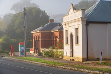 A Streetscape Of Historic Buildings On A Foggy Morning In Chewton, Victoria.