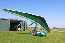Ultralight Airplane On A Grass Airfield