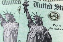 Macro View Of The Statue Of Liberty On Two United States Treasury Checks.