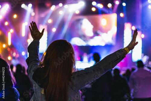 Canvas worship concert in a church woman raised hands