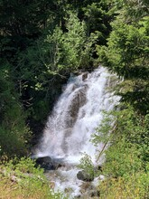A Beautiful Waterfall In Mount Rainer National Park