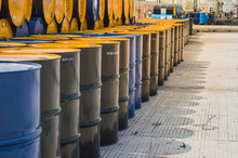 Industry Oil Barrels Or Chemical Drums Stacked Up. Oil Barrels.Stack Of Oil Barrels.