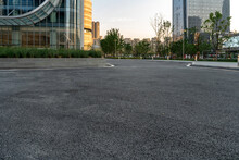 Empty Asphalt Road With Modern Office Buildings In Downtown.