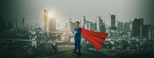 Businessman Superhero  Standing On Building  Rooftop To Looking Cityscape At Night,concept Leadership Organization And Professional Business Success,vision And Motivates Team,brave And Courageous