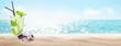 Leinwandbild Motiv Sea beach with hot sand, palm leaves and cocktail