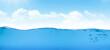 Leinwandbild Motiv Waterline with sea underwater and blue sunny sky