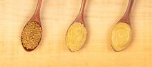 Mustard Seeds, Mustard Powder And Mustard Sauce In Spoons On Wooden Background, Top View, Panoramic, Superfood Concept With Copy Space.