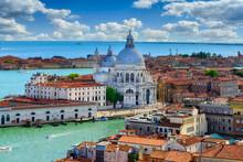 Aerial View Of Venice, Grand Canal And Basilica Di Santa Maria Della Salute In Venice, Italy. Architecture And Landmarks Of Venice. Venice Postcard
